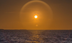 Lens flare (Karthik Andugulapati) Tags: ocean sunset orange sun atlantic lensflare