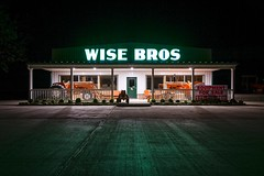 Wise Bros II (Notley) Tags: longexposure windows light tractor shop architecture night facade rural spring farm may missouri callawaycounty nocturne farmequipment 2016 10thavenue notley notleyhawkins callawaycountymissouri missouriphotography httpwwwnotleyhawkinscom notleyhawkinsphotography wisebros wisebrothers