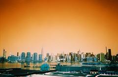 L1537R1-R01-025 (DoubleBen) Tags: city nyc newyork building film skyline brooklyn 35mm spring lomo lomography manhattan turquoise olympus 400 eastriver empirestate 100 asa 135 xa xr iso100400 lomochrome