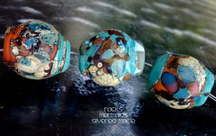 Rocks Mermaids Silvered Matte (Laura Blanck Openstudio) Tags: blue roof red etched usa brown abstract brick green art glass set silver tile beads leaf big italian sand beige rocks colorful published artist glow purple handmade stones eggplant teal maroon fine arts almond violet lavender plum sienna funky jewelry pebbles made odd caramel lilac honey earthy winner copper opaque bead organic mermaid kiln nuggets murano lampwork multicolor raku artisan matte whimsical loose frosted frit openstudio neutral asymmetric ocher speckles silvered annealed openstudiobeads