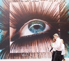 (Martyn61) Tags: life city blue ireland dublin woman man eye mobile poster workers phone lashes streetphotography social fujifilm advertisment workmates allseeingeye gotmyeyeonyou classicchrome x100t