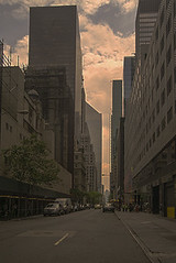 Among The Tall, On The Horizon, Long Narrow Perspective In Manhattan (nrhodesphotos(the_eye_of_the_moment)) Tags: dsc0659372 theeyeofthemoment21gmailcom wwwflickrcomphotostheeyeofthemoment angles horizon outdoor streetlight architecture geometric manhattanstreets shadows reflections auto cars transportation west skyline skyscrapers steel metal glass windows perspective long clouds sky trees scaffolding nyc road buildingcomplex building urban railing construction sidewalk