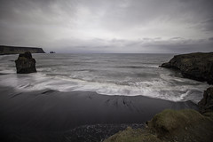The Atlantic Tide (aerojad) Tags: ocean longexposure travel cliff beach nature landscape blacksand iceland sand waves gloomy cloudy dreary wanderlust southcoast atlanticocean blacksandbeach dyrhlaey daytimelongexposure thesouthcoast iceland2016