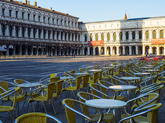 St Marcs square (Nigel Wallace1) Tags: morning venice red italy plants holiday water coffee sunrise buildings hotel boat early cafe chairs olympus tourists explore tables gondola