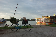 Washing clothes in the Perfume River (judithbluepool) Tags: bike silhouette citadel flag vietnam washing perfumeriver hude touristboat