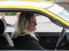 Pennzoil Gal (jamica1) Tags: woman canada smiling driving bc okanagan may columbia days parade blond blonde driver british kelowna rutland