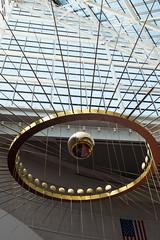 DSCF5777.jpg (mikepirnat) Tags: sculpture art architecture oregon reflections portland flag skylight ceiling pendulum pycon oregonconventioncenter pycon2016