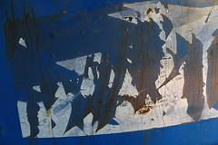 DSC03882 (The Man-Machine) Tags: barrel blue old label torn text texture