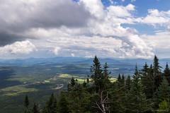 Unsettled Sky (NykO18) Tags: canada clouds estrie forest hills landscape montsaintjoseph montmganticnationalpark mounds northamerica parcnationaldumontmgantic pinetree qc qubec tree trees woods