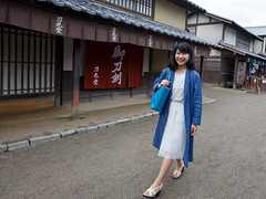 Young woman walking in old Japanese village with smile (Apricot Cafe) Tags: asian asianethnicity canonef1635mmf28liiusm japan japaneseethnicity kyoto lypsekyo16 happiness people swordshop traveldestinations village walking youngadult kytoshi kytofu jp img638479