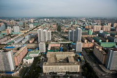 Views of Pyongyang city, the Daedong River and colourful communist apartment blocks taken from the Juche Tower in North Korea, DPRK (tommcshanephotography) Tags: adventure asia communism dprk democraticpeoplesrepublicofkorea expedition exploring kimilsung kimjungil kimjungun northkorea pyongyang revolution secretcompass travel trekking