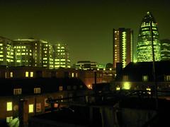 Green view (Gary Kinsman) Tags: city green skyline night view grain 2006 gherkin e1 spitalfields 30stmaryaxe cityoflondon swissretower councilestate socialhousing toynbeestreet cityfringe petticoattower brunehouse hollandestate