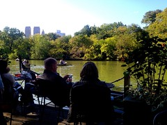 The Loeb Boathouse at Central Park (Maria Eklind) Tags: trees newyork green water boats pub skyscrapers centralpark manhattan bluesky boathouse