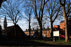 Beaumont Fee, Lincoln (lincoln_eye) Tags: uk greatbritain flowers trees houses winter england urban sign buildings europe apartments shadows unitedkingdom branches january eu sunny bluesky bin lincolnshire spire flats lincoln gb snowdrops paths 2015 beaumontfee stmartinscemetary