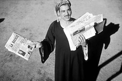 03_Cairo - Newspaper Vendor 1979 (usbpanasonic) Tags: northafrica muslim islam egypt culture nile cairo nil egypte islamic مصر caire moslem egyptians newspapervendor egyptiens