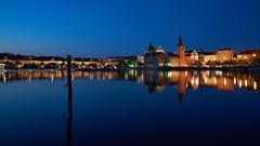 Prague reflections (McQuaide Photography) Tags: old city longexposure travel bridge light reflection building history tourism water stone skyline architecture zeiss river outside twilight europe prague outdoor dusk widescreen sony tripod praha landmark panoramic historic czechrepublic bluehour fullframe alpha 169 charlesbridge vltava touristattraction praag manfrotto c1 1402 czechia stonebridge centraleurope karlvmost capitalcity 1635mm eskrepublika variotessar captureone steleckostrov mirrorless shootersisland sonyzeiss praskmost praguebridge kamennmost bohemiansandstone mcquaidephotography a7rii ilce7rm2 captureonepro9