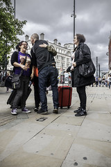 Queue for hugs (tootdood) Tags: trees sky green leaves manchester candid group piccadilly stormy queue hugs fromthehip streetcandid canon70d