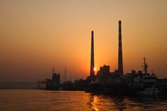 Floating light (AC02 Works) Tags: china bridge light sunset shadow chimney sky ferry river pier smog twilight dock haze glow shanghai  powerplant   powerstation   huangpuriver    yangpu