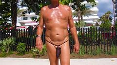 black baggie strap walk (bmicro2000) Tags: man male beach public thong tiny gstring bungee baggie minimalswimwear microkini microbeachwear