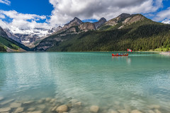 O' Canada! (ScotiaViolet) Tags: lakelouise banff banffnationalpark alberta rockies mountains lake canoe flag canadianflag canada sonyilce6300 e1018mmf4oss sonya6300