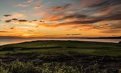 Midnight Golfers (Elin Laxdal) Tags: clouds golf golfers hafnarfjruriceland himinn midnightsun night ntt sea sjr sky sk sunset