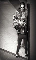 Blind Date (Clare-White) Tags: 2 people man lady bw lookingdown light sunglasses intriuging look amsterdam street