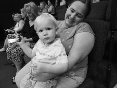 (heatherbirdtx) Tags: baby boy woman cookie eyecontact candid portrait lap expression interior availablelight blackandwhite mother child strangers audience theater crumbs