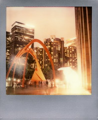 Glowing Bunny (tobysx70) Tags: the impossible project tip polaroid sx70 instant color film for type cameras silver frame edition expired impossaroid glowing bunny bank america plaza hope street dtla downtown los angeles la ca amanda parer intrude urban public art installation illuminated rabbit twilight dusk skyscraper highrise long exposure vanishing point motion blur alexander calder four arches sculpture toby hancock photography
