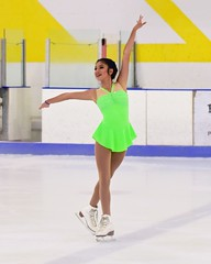 Looking neat in neon... (R.A. Killmer) Tags: ice skate show graceful talented