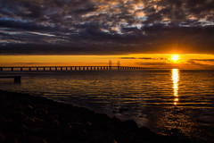 Sunset (Maria Eklind) Tags: bridge sunset sea sky sun reflection beach nature water clouds strand se europe sweden outdoor himmel sverige malm solnedgng moln resund sibbarp resundsbron horisont spegling skneln resundbridge