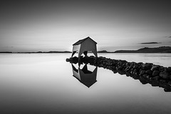 Lonely Boathouse (Karl Erik Vasslag Photography) Tags: ocean sunset sea bw seascape reflection norway landscape pier stavanger blackwhite hafrsfjord rocks boathouse jren madla naust jaeren d810 bthus