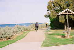 Lazy Sunday cycle (AaronMcAuley) Tags: park water cyclists bay path melbourne cycle