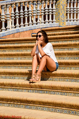 Girl on Steps (Juanito Moore ( John Moore )) Tags: sevilla spain espaa crdoba girl sun shine blue sky buildings medieval lagiralda catedral cathedral river guadalquivir architecture pretty stunning shorts reflections flowers shadows people chinese frog animals colour photo foto photographer fotgrafia