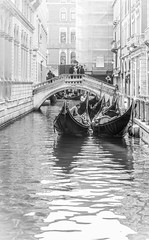 Two Gondolas (and some spare) (calumccampbell) Tags: italy italina italian sun water travel holiday mediterranean med trip canon 1855 60d venice venezia veneto canal river architecture building buildings arch archi boat boats gondola gondolas gondolier sea ocean blue