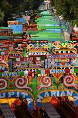Lineup of trajineras (Thomas Roland) Tags: city travel summer colour gardens by america de mexico boats canal sommer central floating ciudad tourist colourful amerika xochimilco trajinera både rejse trajineras kanaler mellemamerika