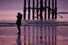 Parallel Lines (Alan MacKenzie) Tags: sunset shadow woman reflection beach silhouette pier sand brighton dusk