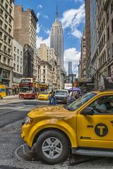 5th Avenue Life (JUANJO CAMPA) Tags: street blue sky usa newyork bus shop clouds skyscraper shopping raw manhattan taxi 5thavenue empirestatebuilding avenue d800