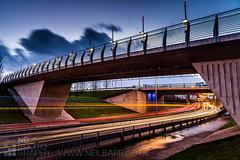 Glasgow Harbour Footbridge (GenerationX) Tags: road bridge blue red orange trafficlights concrete lights scotland footbridge unitedkingdom glasgow scottish neil lighttrails expressway railings barr glasgowharbour gillespies