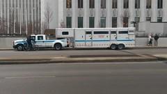Cops (BradPerkins) Tags: blue chicago bicycle waiting cops loop police trailer chicagoist bikecop commandvehicle