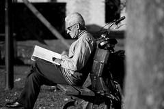 Just a book (Ondeia) Tags: old people bw persona libro bn fotografia albero bianco lettura nero occhiali bicicletta leggere signore anziano