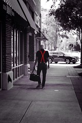 Man In Red (thiaacorn) Tags: city red man suspenders selectivecoloring