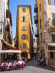 Old Town. (Johnners61) Tags: street old city france colour pen four lumix town cafe nice alley pavement balcony olympus panasonic micro shutters balconies colourful quaint olympuspen oldtown southoffrance narrow thirds vario m43 mft 1232 microfourthirds epm2