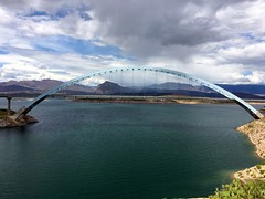 Roosevelt Lake Bridge is the longest two-lane, single-span, steel-arch bridge in North America. The bridge, spanning 1,080 feet across Roosevelt Lake, was painted blue to blend in with the lake and sky, letting the form speak. (anshanjohn) Tags: arizona rooseveltlakebridge