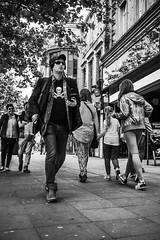 Johnny Kidd? (tootdood) Tags: blackandwhite manchester skull piccadilly shades pirate crossbones fromthehip streetcandid johnnykidd canon70d