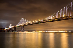 Bay Bridge (Saad Chdhry) Tags: sanfrancisco california longexposure bridge usa reflection art water night clouds landscape bay cityscape bayarea saadchdhry