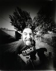 No Lens To Crack (snarfusmaximus) Tags: image kodak tmax banjo wanker pinhole 400 4x5 zero selfie xtol 25b
