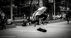 to feel alive (Edwin M. Glez) Tags: street boy white black blanco contrast speed canon walking mexico 50mm fly frozen flying spring jump emotion strasse air negro guadalajara skate skateboard instant salto alive nio weiss schwarz junge impossible t3i chapultepec muchacho congelado 600d