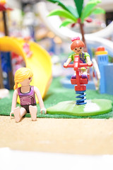 BANGKOK - MAY 1, 2016 : Portrait of Playmobil girls on the ride at water park. Soft focus on the right girl with red hair. Summer time & Summer holiday concept. Bright & colourful summer style filter (enchanted.fairy) Tags: