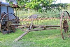 Tilling the Land (C. VanHook (vanhookc)) Tags: wheel vintage rust seat wheels rusty emptyseat farmequipment tilling 52in2016 springtimeattheiowastatefairgrounds