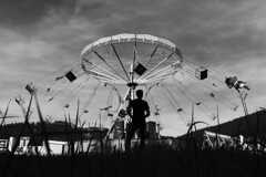 Chain Carousel (Marek Kalich) Tags: carnival sky people blackandwhite nature grass silhouette fun outdoors czech empty joy carousel chain enjoy chairplane
